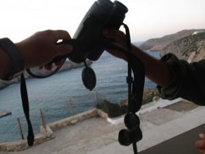 Raptor counters passing the binoculars